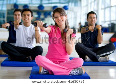 Gym people at an aerobics class with free weights - stock photo