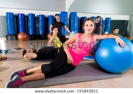 Gym people group relaxed after training with fitball workout - stock photo