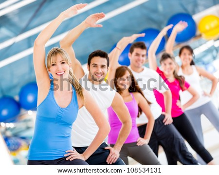 Gym people stretching and looking very happy - stock photo
