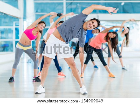 Gym people stretching in a class before workout