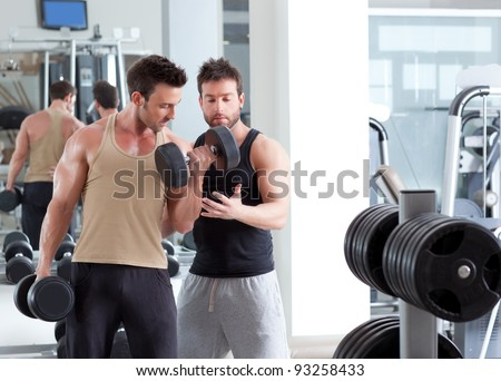 gym personal trainer man with weight training equipment - stock photo