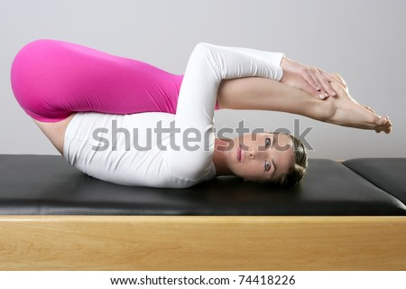 gym pilates woman reformer yoga leg sport young girl - stock photo