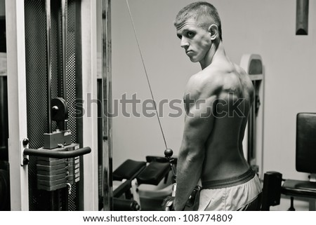 Gym practice - training triceps. Black and white