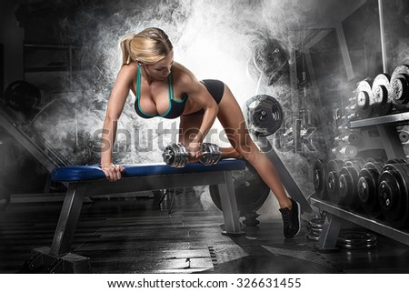 Gym.Sporty girl posing  - stock photo