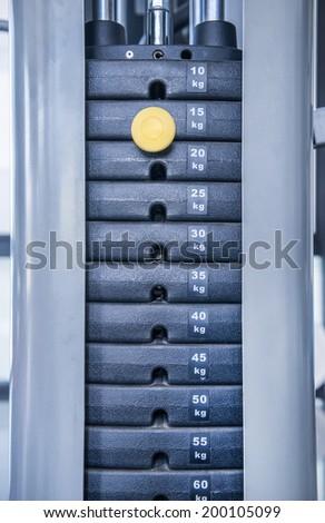 gym weight machine. Amount of weight on lifting machine - stock photo