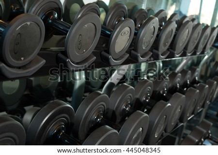 Gym weights and equipments on a sunny day  - stock photo
