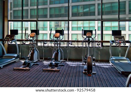 gym with large windows and a stationary bike - stock photo