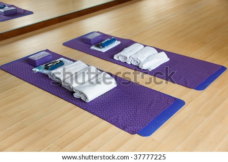Gym with mat and other exercising materials prepared for yoga - stock photo