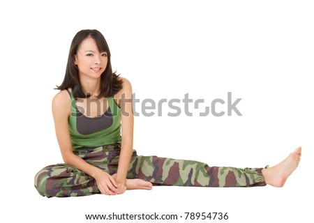 Gym woman doing stretch excise on ground, full length portrait isolated on white background. - stock photo