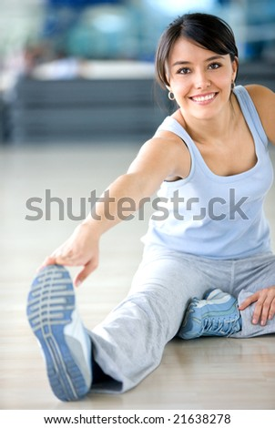 gym woman doing stretching exercise at the gym