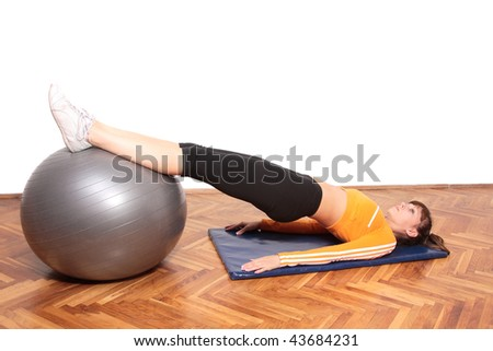 gym woman doing stretching exercise at the gym - stock photo
