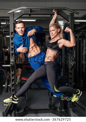 Gym woman exercising with her personal trainer - stock photo
