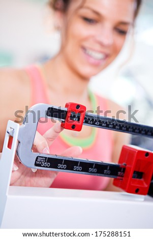 Gym: Woman Happy About Weight Loss - stock photo