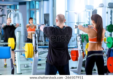 gym woman personal trainer man. - stock photo
