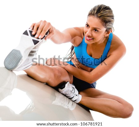 Gym woman stretching leg - isolated over a white background