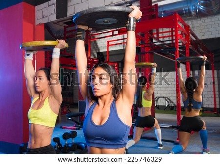 Gym women barbell plates rising workout exercise together - stock photo