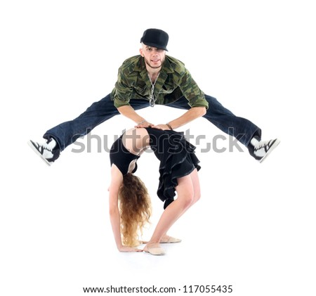 Gymnast does bridge and rapper jump above her isolated on white background. - stock photo