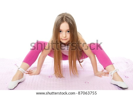 gymnast little girl isolated on white - stock photo