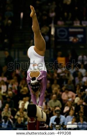 gymnast on beam - stock photo