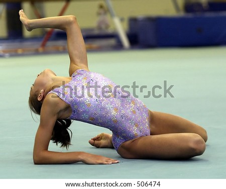 gymnast on floor in the finish position - stock photo