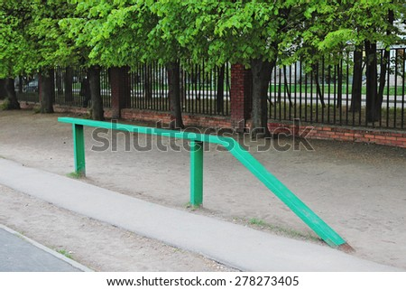 gymnastic balance beam on the natural background of the playground