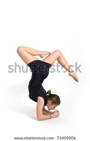 Gymnastic Girl over white background. Studio shot. - stock photo