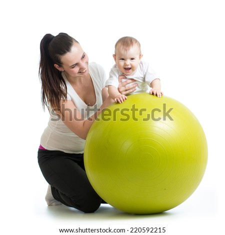 gymnastics for baby  with fitness ball - stock photo