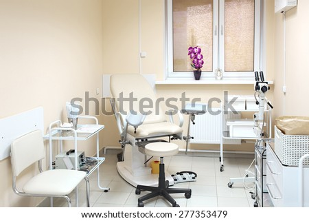 Gynecological chair. Gynecological room in private clinic - stock photo