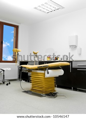gynecology chair yellow in hospital room clinic - stock photo