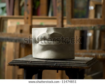 Gypsum model of lips in painting studio interior - stock photo
