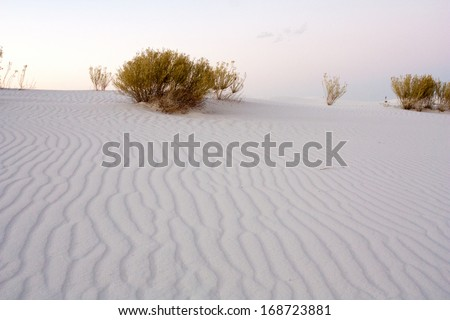 Gypsum sand dune shapes at dusk in White Sands National Monument, New Mexico - stock photo