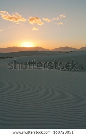 Gypsum sand dune shapes at sunset in White Sands National Monument, New Mexico - stock photo