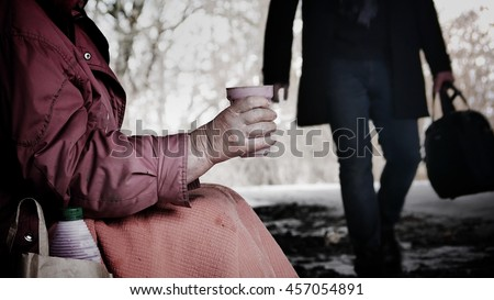 Gypsy asks for charity - homeless  - stock photo