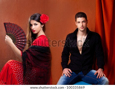 Gypsy flamenco dancer couple from Spain with red rose and spanish hand fan - stock photo