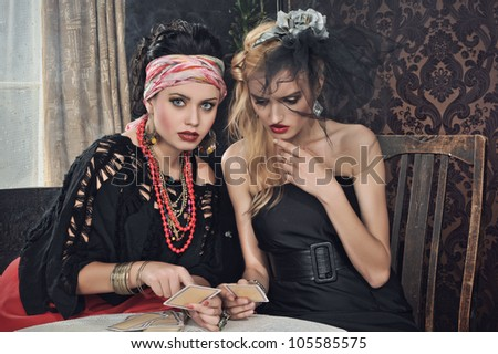 Gypsy fortune-teller cards spells - stock photo