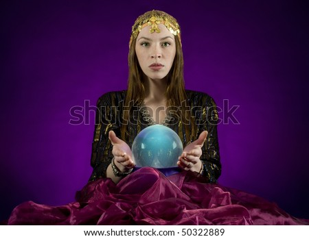 Gypsy fortune-teller with crystal ball - stock photo