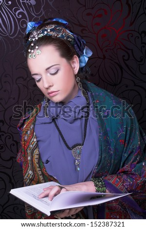Gypsy girl. Portrait of young woman in ethnic costume.