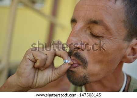 gypsy man smoke - stock photo