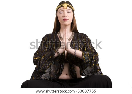 Gypsy sits in prayer and meditates - stock photo