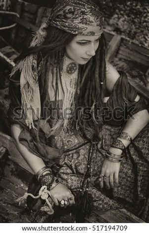 gypsy style young woman in boat