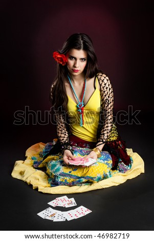 Gypsy woman tell fortunes by cards - stock photo