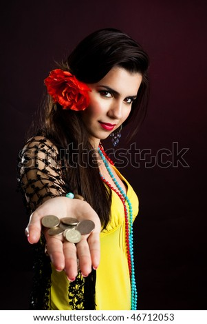 Gypsy woman with palm full of coins - stock photo