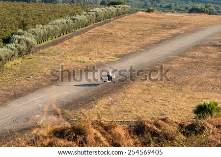 Gyrocopter single pilot prepares to land on the small track - stock photo