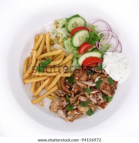 Gyros with french fries and vegetable - stock photo