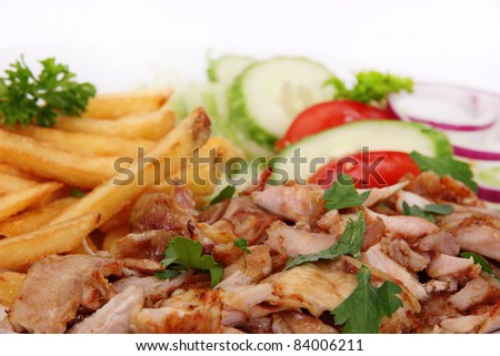 Gyros with french fries and vegetables - stock photo