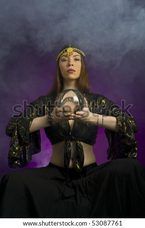 Gyspy fortune-teller with crystal ball - stock photo