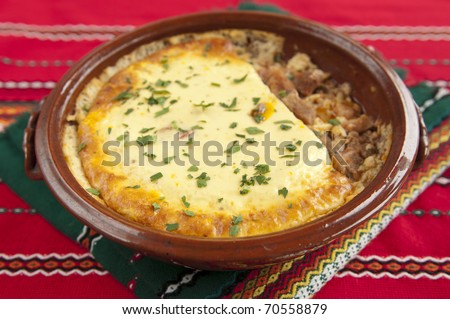 Gyuvetch is a Bulgarian, Macedonian and Serbian oven-baked meat and vegetable stew similar to ratatouille - stock photo