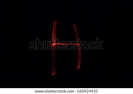 H - torch light alphabet letters - stock photo