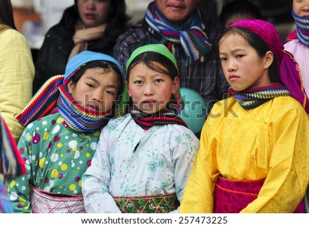 Ha Giang, Viet Nam - Feb 19, 2012:Unidentified traditionally dressed girls of Hmong ethnic minority tribe in Vietnam. Hmong people are known for their indigo-dyed costumes and ornate silver jewellery. - stock photo