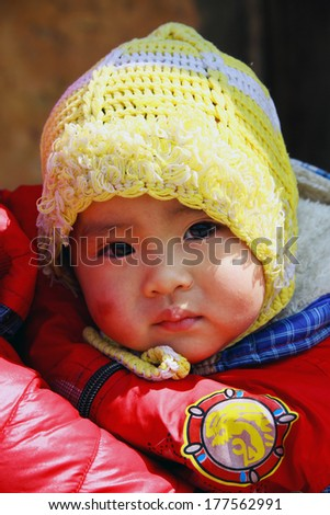 HA GIANG, VIETNAM - FEB 15: Unidentified kid Ethnic Minority People at Market on February 15, 2014 in Ha Giang , Vietnam.
